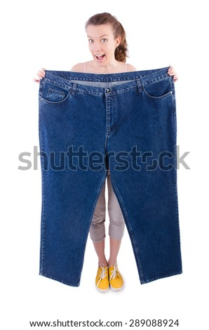 Woman with oversized jeans in dieting concept - stock photo