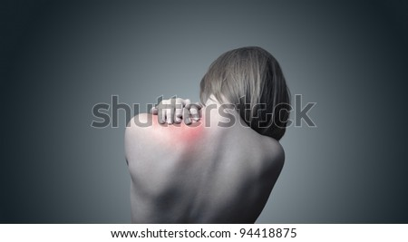 Woman with pain in her neck and shoulder - stock photo