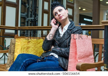 Woman with paper bags sitting on the bench