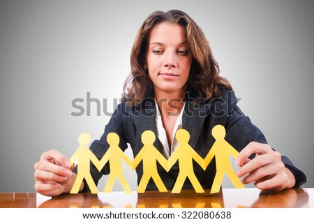 Woman with paper cut people - stock photo
