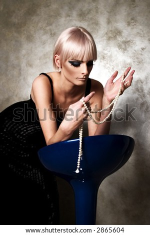 Woman with pearls - stock photo