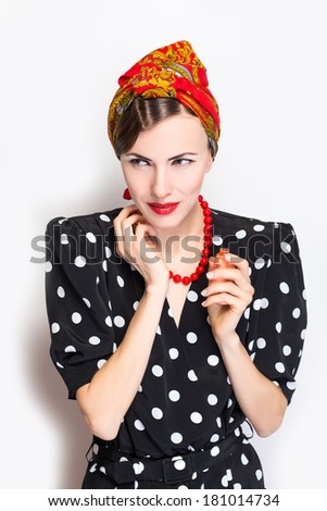 Woman with perfume, young beautiful girl holding bottle of perfume and smelling aroma - stock photo