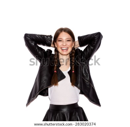 Woman with pigtails in black leather jacket. White background not isolated - stock photo