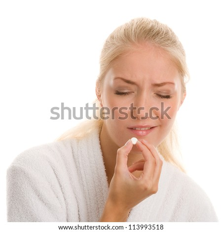Woman with pill - stock photo