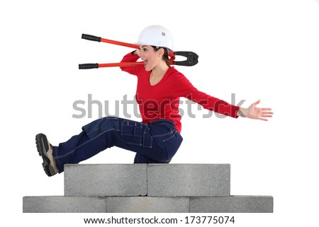 Woman with pincers jumping - stock photo