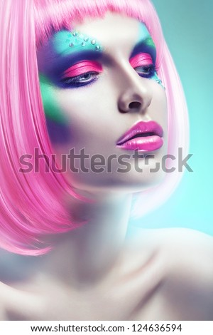 woman with pink hair in blue light - stock photo