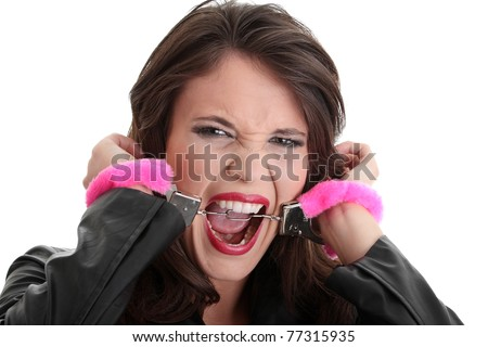 Woman with pink handcuffs trying to get free - stock photo