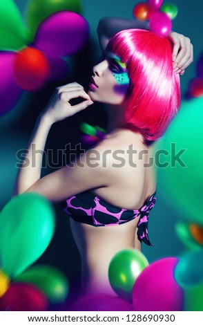 woman with pink wig in balloons - stock photo