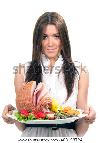Woman with plate delicious whole baked honey sliced ham meat strawberries vegetable salad carrots asparagus lemon for dinner isolated on a white background - stock photo