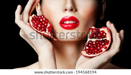woman with Pomegranate. professional makeup - stock photo