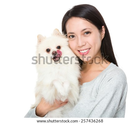Woman with pomeranian dog - stock photo