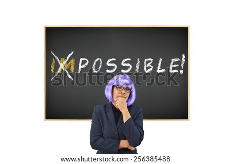 Woman with purple hair IMPOSSIBLE POSSIBLE on blackboard isolated with white background - stock photo