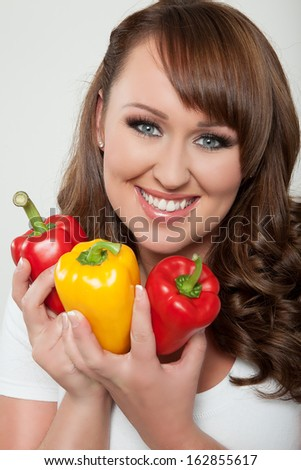 Woman with red and yellow paprika
