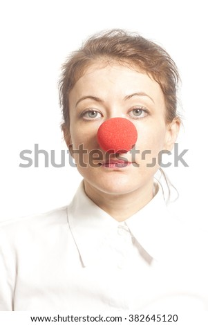 Woman with red clown nose isolated on white background - stock photo