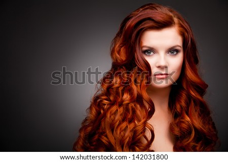 woman with red curly hair - stock photo