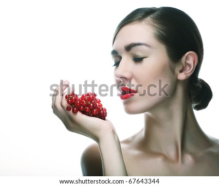 woman with red currant. isolated on white. - stock photo