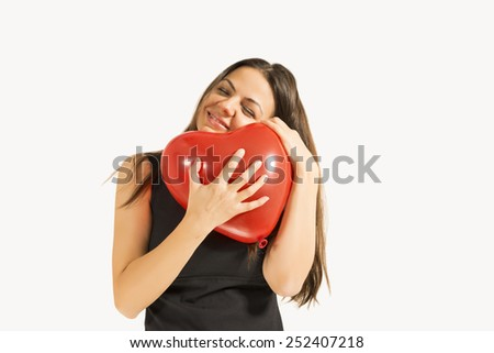 Woman with red heart balloon smiling,isolated on a white background. Love and valentines day. - stock photo
