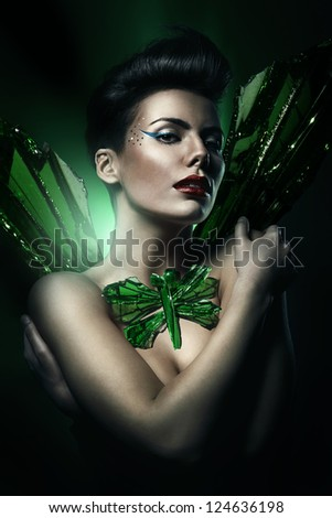 woman with red lips and glass dragon-fly on body - stock photo