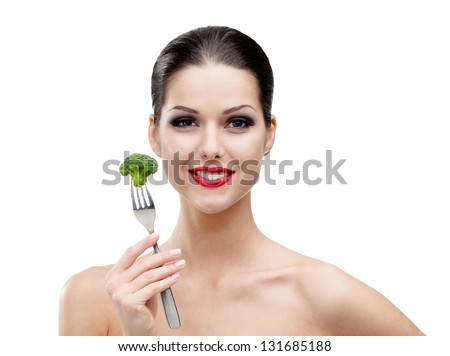 Woman with red lipstick eating healty broccoli on the stainless fork, isolated on white. Fresh and healthy dieting food - stock photo