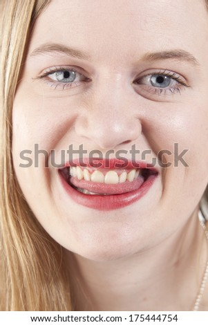 Woman with red lipstick smiling.GN
