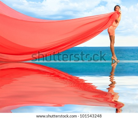 Woman with red scarf on water - stock photo