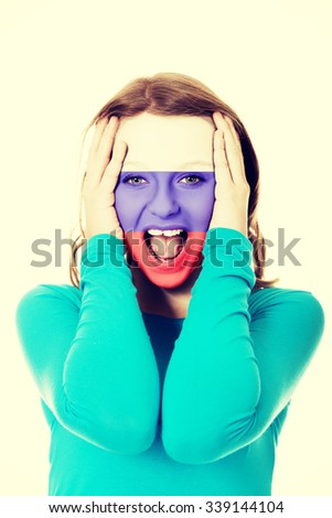 Woman with Russian flag painted on face. - stock photo
