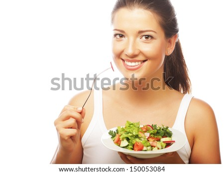 woman with salad on white background - stock photo