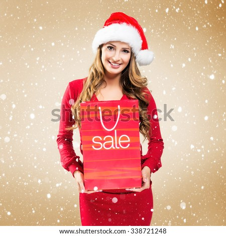 Woman with SALE bag -  on gold  background - stock photo