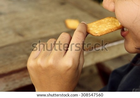 woman with salty Cracker