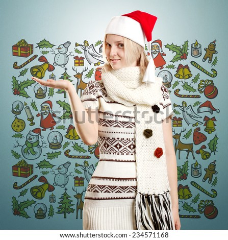 Woman with Santas hat waiting for Christmas, with open hand - stock photo