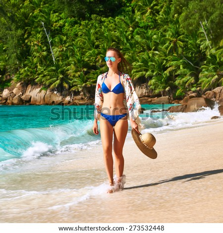 Woman with sarong on beach Anse Intendance at Seychelles, Mahe - stock photo
