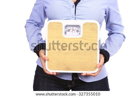woman with scale - stock photo