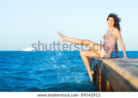 woman with sea - stock photo