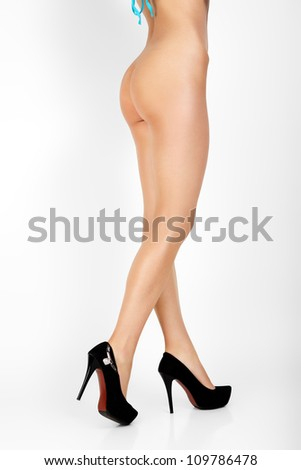 Woman with sexy legs isolated on white background.