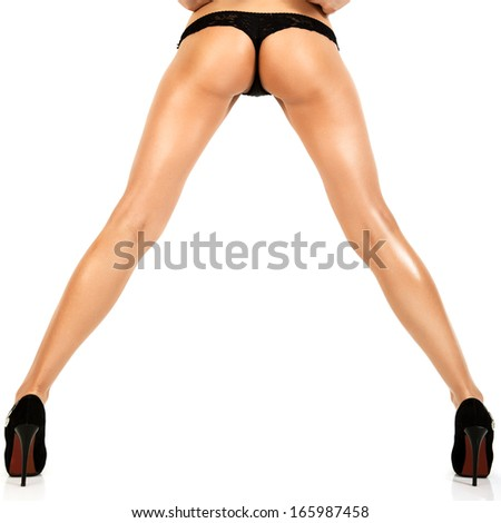 Woman with sexy legs isolated on white background.  - stock photo