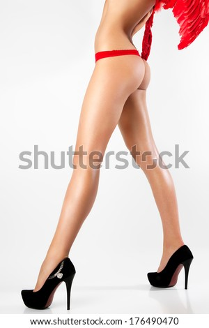 Woman with sexy legs isolated on white background. Girl with angel wings.