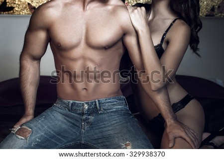 Woman with sexy macho body at night - stock photo