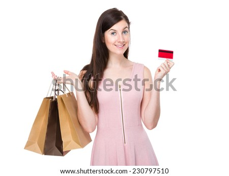 Woman with shopping bag and credit card - stock photo