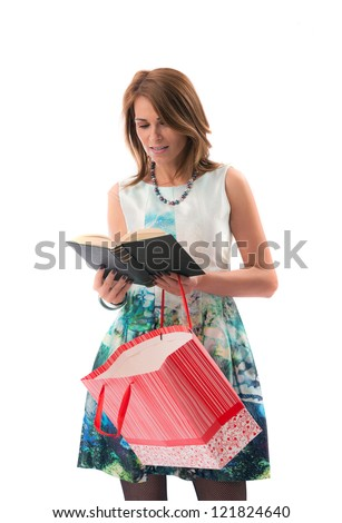 woman with shopping bag reading a book - stock photo