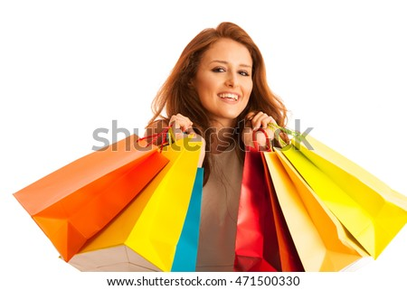 Woman with shopping bags after a successful purchase on the sale isolated over white