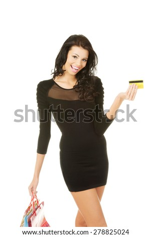 Woman with shopping bags and credit card. - stock photo