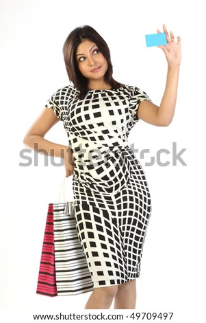 Woman with shopping bags and credit card - stock photo