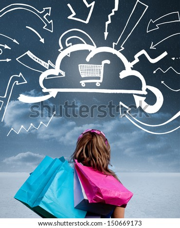Woman with shopping bags and looking at a drawing with shopping cart into a cloud