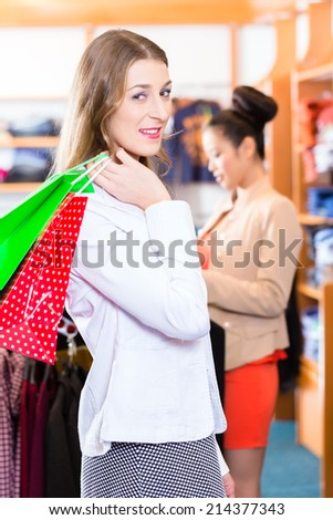 Woman with shopping bags in shop or store