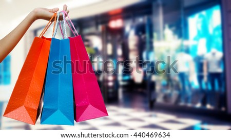 Woman with shopping bags in shopping mall