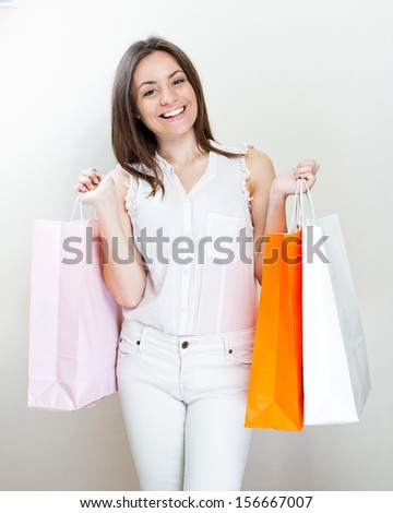 woman with shopping bags. Smiling happy girl .