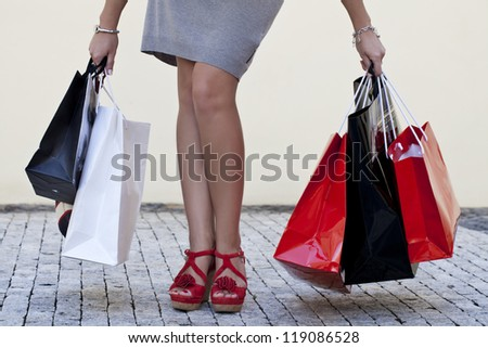 Woman with shopping bags walking on the street in Prague. - stock photo