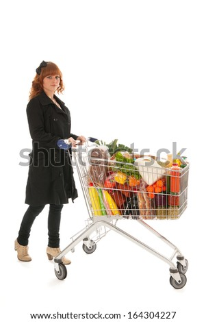 Woman with shopping cart full with dairy grocery products isolated over white background