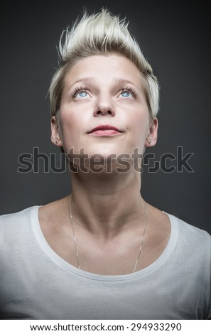 Woman with short blond hair.