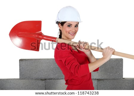 Woman with shovel - stock photo
